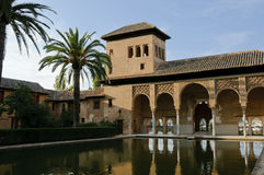 Moorish architecture in the Alhambra. The so called Palacio del Portico, the most ancient palace inside the Alhambra complex of Granada, reflecting in the water stock image