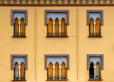 Moorish architecture. Facade in typical moorish arcitecture, decoration and colors. dominant colors are yellow and blue. Seen in marrakech Royalty Free Stock Photos