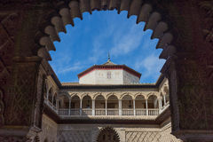 Moorish dome through in the pointed arch in Seville, Spain, Euro. Pe on a summer day Royalty Free Stock Photo