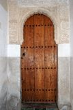 Moorish doorway, Alhambra Palace. Arabic writings carved into arch around doorway in the Palace of Alhambra, Granada, Granada Province, Andalusia, Spain Royalty Free Stock Image