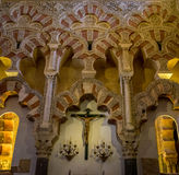Moorish intricate design on the arch  above the cross inside the. Mezquita de Córdoba,the Great Mosque of Córdoba, Mosque-Cathedral,Mezquita Stock Photo