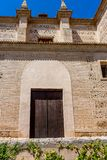 Moorish Islamic Arch above a wooden door in Granada, Spain, Euro. Pe on a bright sunny day Royalty Free Stock Images