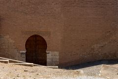Moorish Islamic Arch above a wooden door in Granada, Spain, Euro. Pe on a bright sunny day Royalty Free Stock Photos