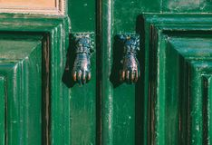Moorish style door handles captured in Cascais, Portugal. Also known as Fatimah`s Hand stock photography