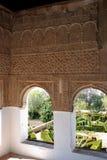 Moorish windows, Palace of Alhambra, Granada. View through Moorish windows of the Generalife, Place of Alhambra, Granada, Granada Province, Andalusia, Spain royalty free stock photography