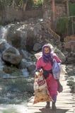 Moorish woman crossing a bridge Stock Image
