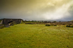 Moorland farming on dartmoor devon. Stone bridge and stormy clouds on the moors Royalty Free Stock Image