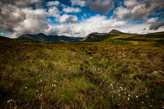 Moorland and mountains. Scottish landscape of mountains and moorland beneath a showery sky stock photography