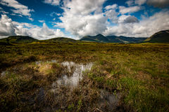 Moorland and mountains. Scottish landscape of mountains and moorland beneath a showery sky royalty free stock images