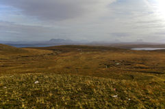 Moorland near Point of Stoer, Assynt, Sutherland, Scottish Highlands. Vast expanse of moorland and heather with lakes and mountains in the distance Royalty Free Stock Image