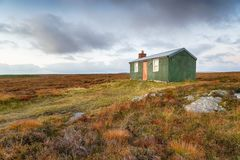 Moorland at Stornoway. An old hut on moorland near Stornoway on the Isle of Lewis in the Western Isles of Scotland stock photos