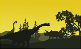 At moorning triceratops and brachiosaurus silhouette in fields Stock Photos