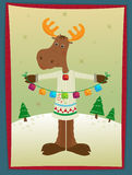 Moose and Bells. A holiday moose holding colorful bells is standing on a snowy hill with trees in the background. Eps10 Royalty Free Stock Photo