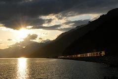 Moose Lake,Canadian Rockies,Canada. Moose Lake in Mt. Robson Provincial Park,freight train running on its lakeside,and the setting sun,Canadian Rockies ( Royalty Free Stock Photo