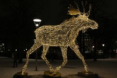 Moose on line. Moose parade lights up in the dark on Nybroplan in Stockholm Royalty Free Stock Photography