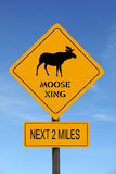 Moose Xing warning roadsign. Over blue sky Stock Photography