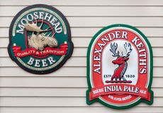 Moosehead and Alexander Keith's Signs. EASTERN PASSAGE, CANADA - DEC 28, 2014: Moosehead is a Canadian independent brewery, based in Saint John, NB. Alexander Stock Photos