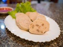 Mooyor or vietnamese sausage pork on plate. Closeup mooyor or vietnamese sausage pork on plate Stock Image