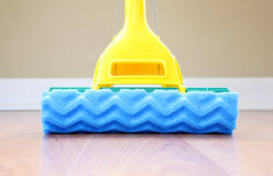 Mop. A close up of a mop on the floor royalty free stock photo