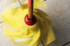 Mop. Yellow mop cleaning the floor Stock Photo