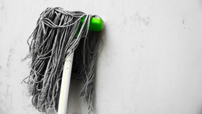 The Mop. A mop being placed on the wall after being used royalty free stock photography