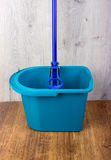 Mop and blue bucket Stock Photos