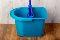 Mop and blue bucket Royalty Free Stock Images