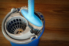 Mop and blue bucket ready for cleaning floor Royalty Free Stock Photos
