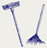 Mop and broom Royalty Free Stock Photography