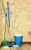 Mop, broom and bucket with detergent Stock Image