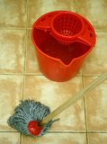 Mop and bucket. Cleaning at home with mop and bucket stock image