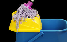 Mop with a bucket. A colorful mop with a bucket royalty free stock images