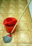 Mop and bucket on the floor. Cleaning at home with mop stock photo