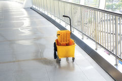 Mop bucket on floor in office building Royalty Free Stock Photos