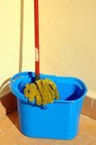 Mop and bucket. Royalty Free Stock Image