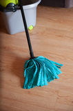 Mop with a bucket Stock Images