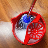 Mop in bucket with water. Top view of mop in bucket with water for cleaning royalty free stock images