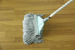 Mop for cleaning wooden floor from dust Royalty Free Stock Photos
