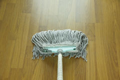 Mop for cleaning wooden floor from dust Royalty Free Stock Photo