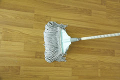 Mop for cleaning wooden floor from dust Stock Photo