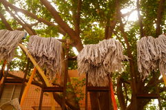 The mop cloth hanging on the iron railings Stock Images