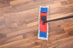 Mop On Hardwood Floor Royalty Free Stock Photos