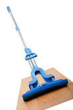 Mop on hardwood floors Royalty Free Stock Image