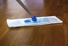 The mop on the parquet floor Stock Image