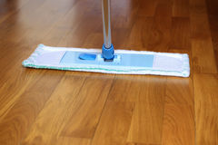 The mop on the parquet floor Royalty Free Stock Photo