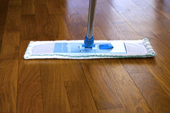 The mop on the parquet floor Stock Photo