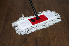 The mop on the parquet Stock Photo