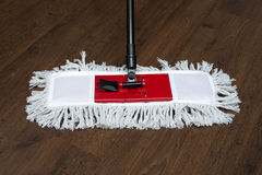 The mop on the parquet Royalty Free Stock Image