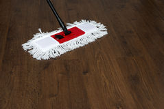 The mop on the parquet Royalty Free Stock Images
