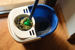 Mop in plastic bucket Royalty Free Stock Photo